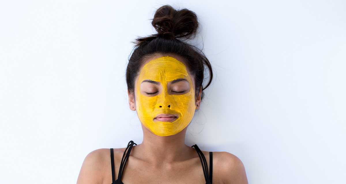 Image result for WOMAN WITH turmeric  MASK